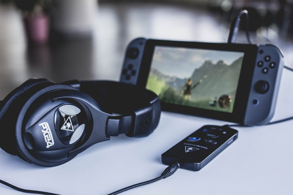 The Turtle Beach PX24 headset with SuperAmp plugged into the Nintendo Switch.