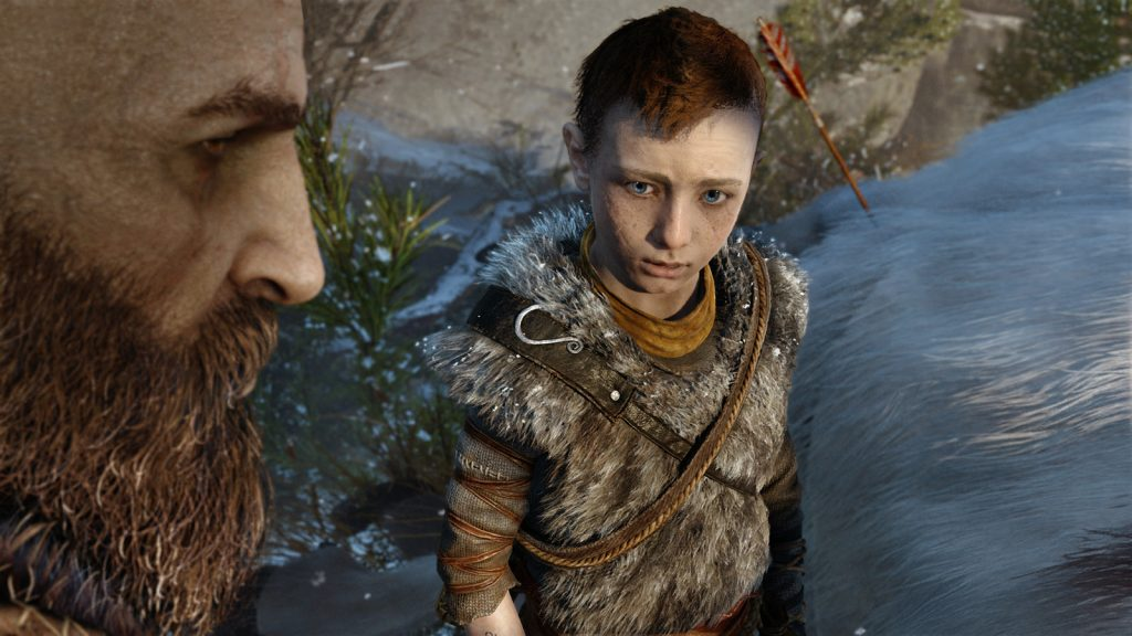 Atreus and Kratos in God of War for PlayStation 4.