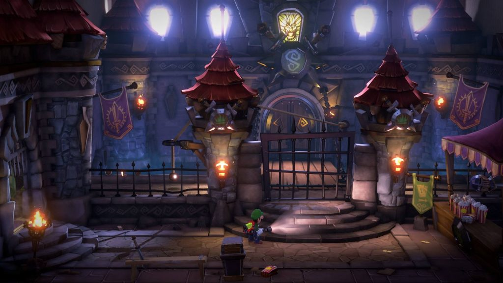 Luigi with ghost busting pack and flashlight standing scared in front of a gate outside a dastardly looking courtyard