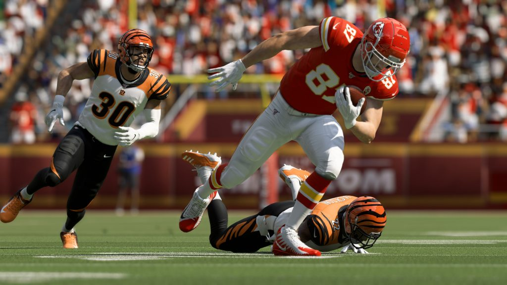 Offensive player from the Kansas City Chiefs got past two defensive players from the Cincinnati Bengals.