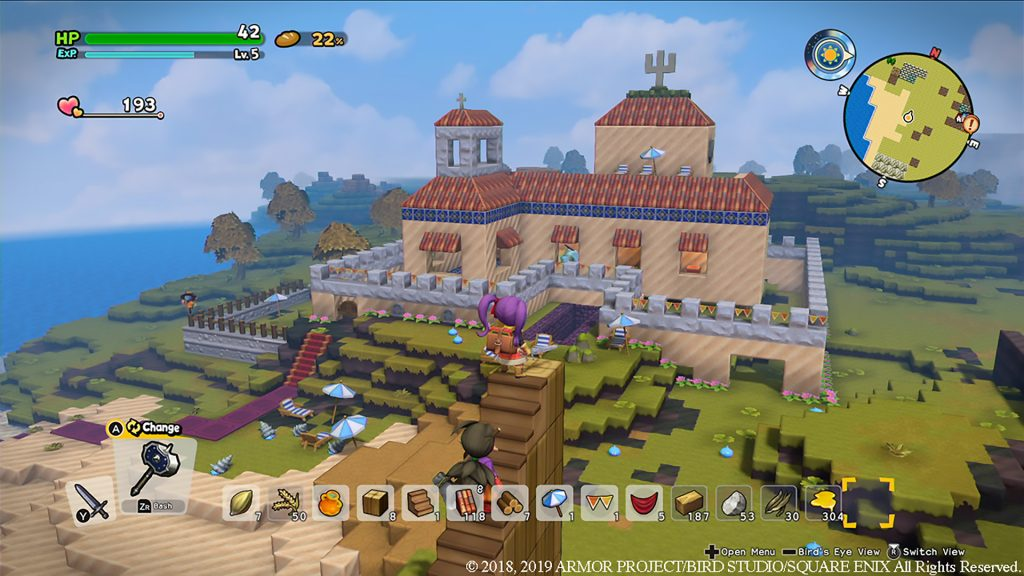 Purple haired female hero of Dragon Quest 2 atop built stairs looking over landscape at building in distance