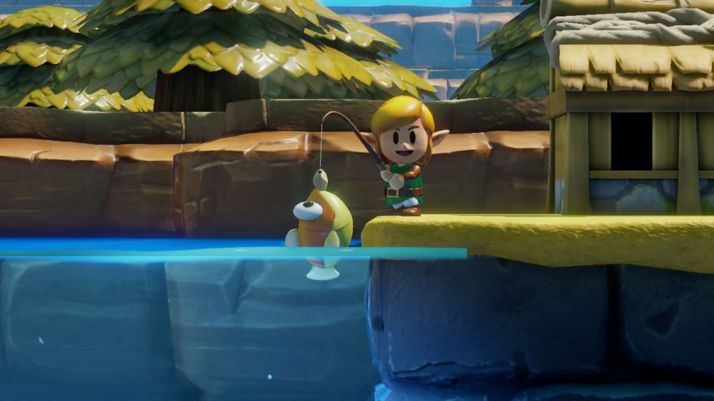 Link happily holding up a caught fish