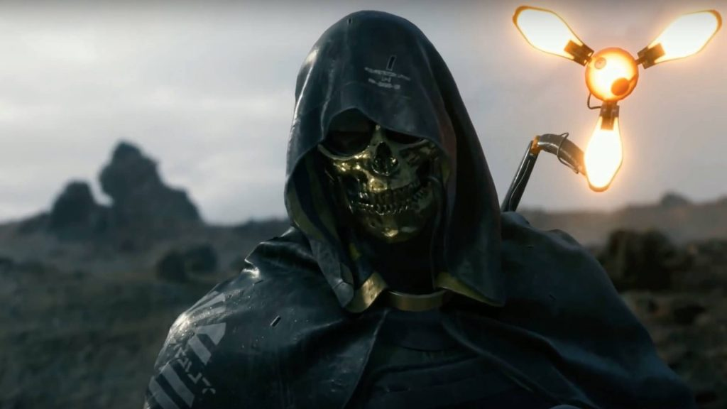 A soldier with a gold mask and a hood looking pretty dang mysterious