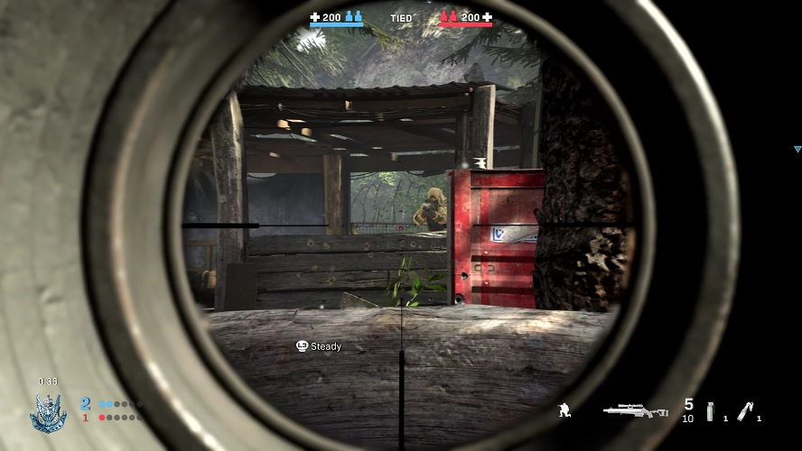 A sniper looking down his scope takes aim at an enemy sniper in cover in a gilly suit