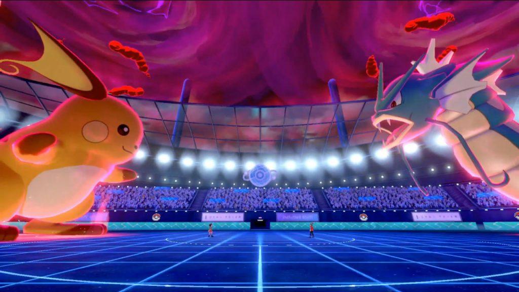 Two Dynamaxed pokemon, a Raichu and a Gyrados, face off in a pokemon arena