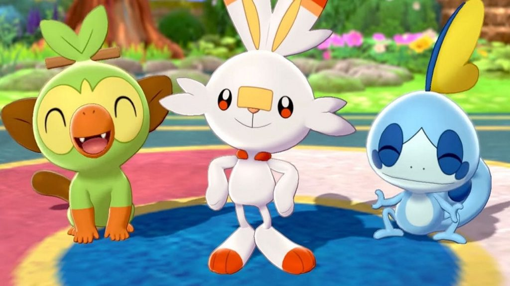 Three elemental pokemon, Grookey, Scorbunny and Sobble stand together.