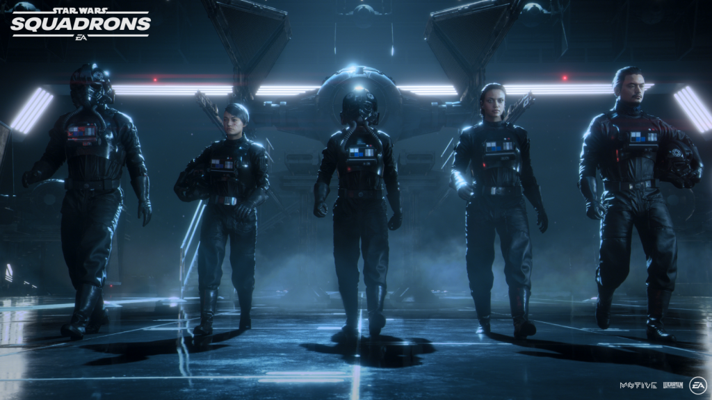 5 imperial figher pilots clad in black walk side by side facing forward, while in front of a tie fighter inside of a large cargo bay lit from above and behind.