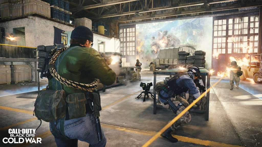 Players shoot it out through an open warehouse.