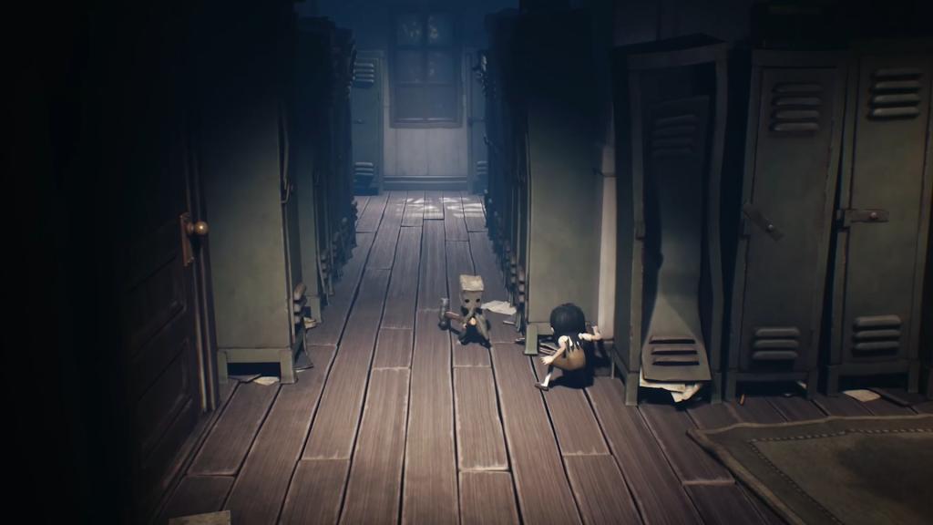 Mono wielding a hammer against an enemy in a school hallway.