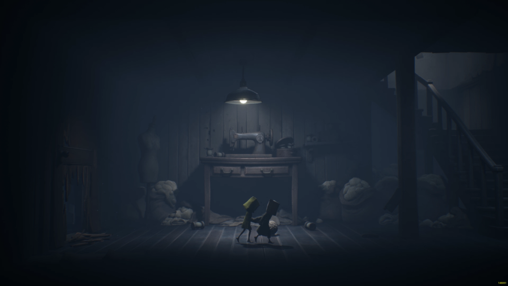 Mono and Six walking across a dimly lit hall in front of a sewing machine