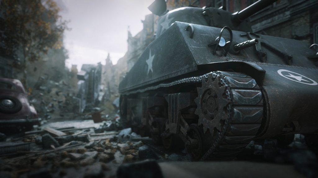 A tank rolls through a debris-filled street.